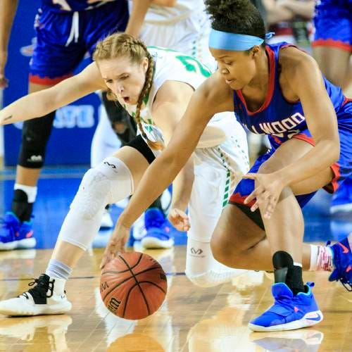 Adair's Autumn Hines (25) and Millwood's Nykale Cramer (33) go after a loose ball during a Class 3A state tournament semi final basketball game between Millwood and Adair in Jim Norick Arena at State Fair Park in Oklahoma City, Okla. on Friday, March 8, 2019.   Photo by Chris Landsberger, The Oklahoman