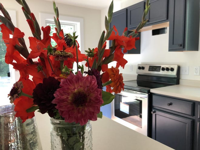 Flowers adorn a tabletop in the kitchen at the new home that Kennebunkport Heritage Housing Trust has built in its new local neighborhood, Heritage Woods.