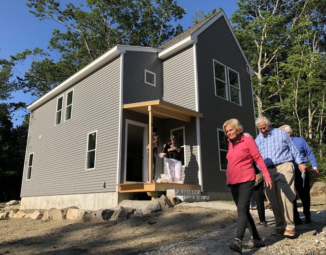 Kennebunkport Heritage Housing Trust will hand over the keys to the owners at its first completed home at Heritage Woods on Friday, July 30.