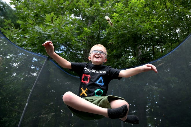 Brycen Berube, 9, jumps on the trampoline at his Somersworth home on Wednesday afternoon.