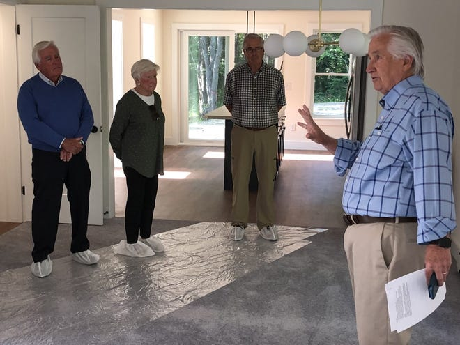 KHHT board member Patrick Clancy leads visitors on a tour of the organization's first completed home at Heritage Woods on Wednesday, July 28.