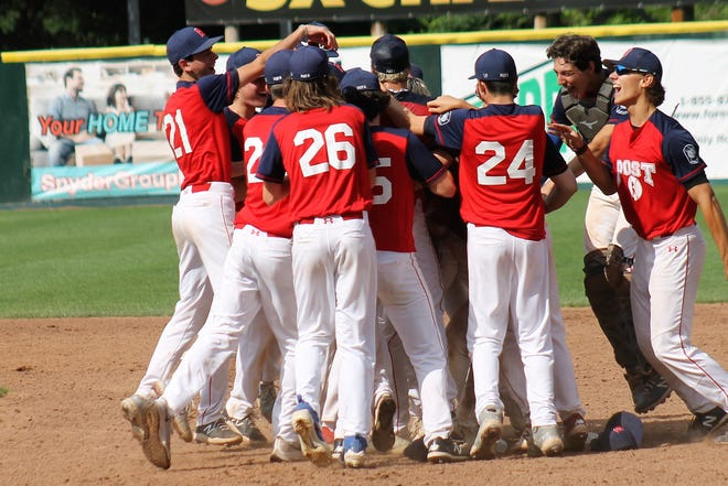 Portsmouth teammates mob winning pitcher Boden Driscoll after the left-hander shut down Nashua on one hit in the Sr. Legion state championship game Wednesday at Holman Stadium.