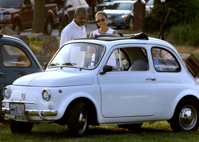 Joe and Arlete Tavares, of Attleboro, Mass., examine a micro-size 1970 Fiat 500 owned by Burt DiMartino.