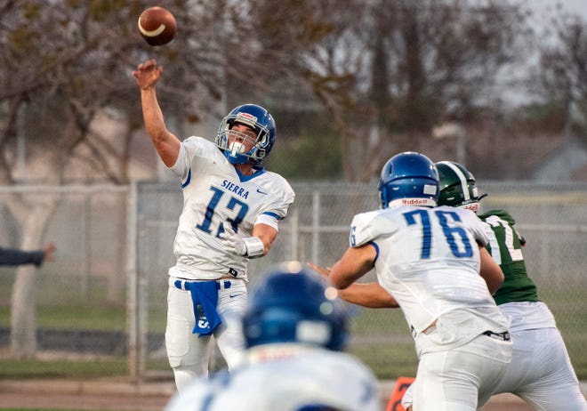 Sierra's Jack Cunial throws a pass during a varsity football game April 1 at Manteca's Guss Schmiedt Field.