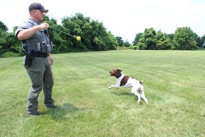 K-9 Tex and his handler, Missouri Department of Conservation Agent Corporal Alan Lamb.