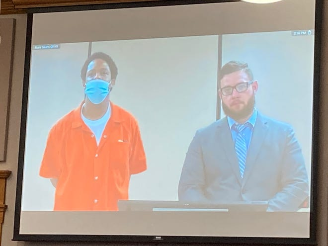 Travonce Backie, left, was sentenced Thursday to five to 7 1/2 years in prison for a March road rage attack in Canton. He is pictured at the Stark County Jail with defense attorney Ty Graham.