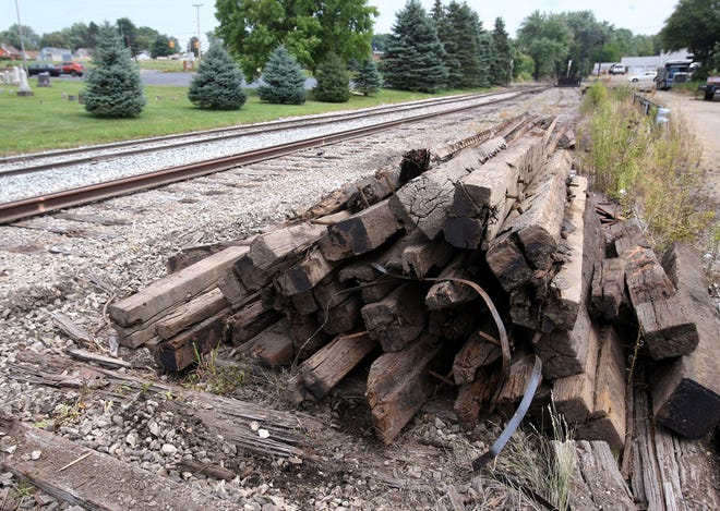 Old railroad ties were piled up last month along the track by the Wheeling & Lake Erie Railroad on the south side of East Canton on Cedar Street.