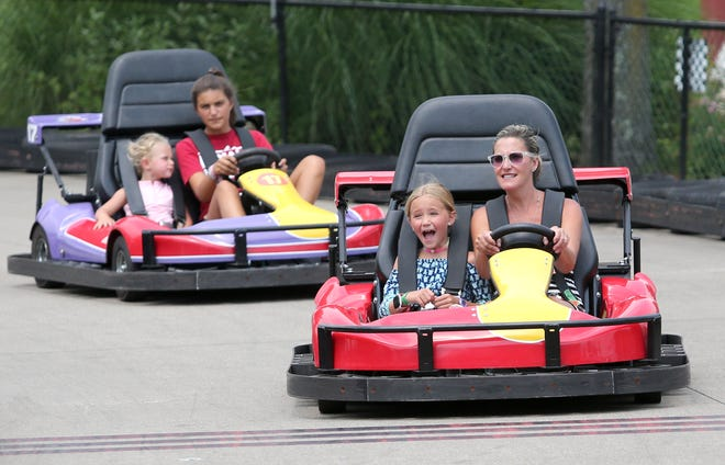 Rian O'Dear, right, celebrates her daughter Landry O'Dear's ninth birthday July 27 while riding the F-22 Raptor Go Karts at Sluggers & Putters Amusement Park in Canal Fulton.