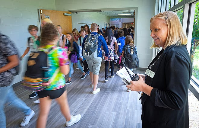 Switzerland Point Middle School principal Sandra Brunet stands in a hallway during a class change at the school in 2019.