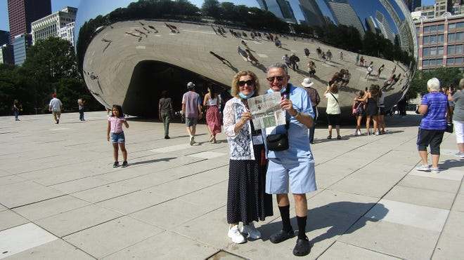 While touring Chicago, Lucia Drain and Aubrey (Ozzie) Boutin took The Record along. They are shown here with the Cloud Gate sculpture which is the center piece of Millennium Park.