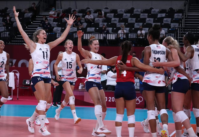 Former Purdue standout Annie Drews (11) celebrates with her U.S. teammates after upsetting defending Olympic champion China on Tuesday. Drews came off the bench Thursday to help lead Team USA to a five-set win over Turkey, securing a spot in the quarterfinals.