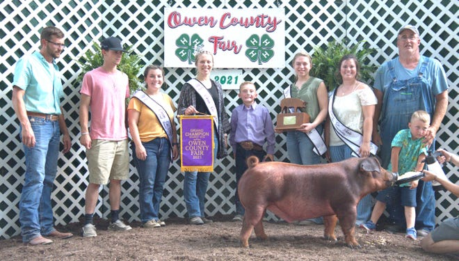 TJ Rice won the Grand Champion banner for his top Market Hog at the 2021 Owen County Fair. Rice is shown alongisde family and friends, as well as the 2021 OC Fair Royalty.
