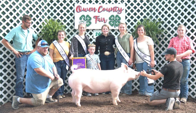 Kailee Cooper, center, exhibited the Grand Champion Gilt at the 2021 Owen County Fair Swine Show. Cooper is shown above with family, friends and the 2021 OC Fair Royalty.