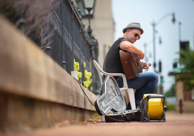 """Springfield singer, songwriter and guitarist Micah Walk will preform Friday night at 3Sixteen Wine Bar as part of the Community Foundation for the Land of Lincoln and the Springfield Area Arts Council's """"Back to the Music"""" project. [Justin L. Fowler/The State Journal-Register]"""