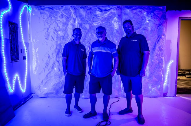 """Brett Moore, Rick Briggs and Nathan Millspaugh stand in the """"The Heist Super Spy"""" escape room experience currently under construction at their new venture, Amazing Xscapes, in the The Yard Shopping Center in Springfield on Wednesday. [Justin L. Fowler/The State Journal-Register]"""