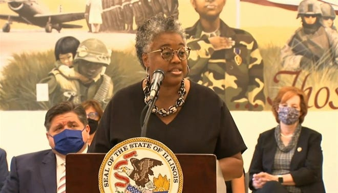 Karen Davis, deputy director of the Illinois Housing Development Authority, speaks at a bill signing event for a measure increasing tax incentives for building affordable housing in Illinois. She said 250,000 affordable housing units are needed in Illinois to meet demand. At left is Gov. JB Pritzker.