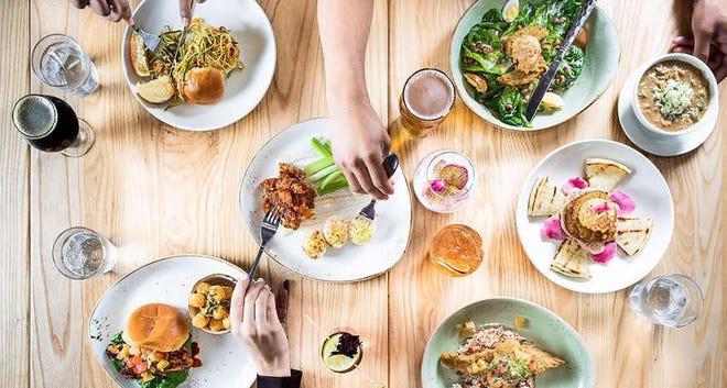 A dinner spread at Chicken+Beer, a Ludaris-owned restaurant in Atlanta's Hartsfield-Jackson International Airport