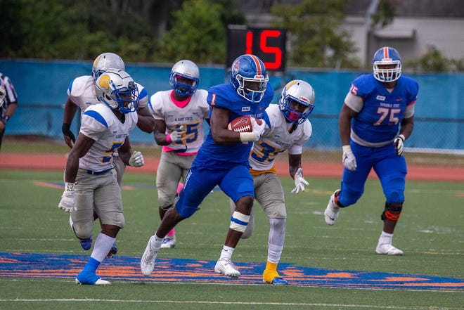 Savannah State's D'Angelo Durham (1) breaks through the line and rushes for a for a 62-yard touchdown against Albany State during the 2019 season at T.A. Wright Stadium. Durham was selected the SIAC Preseason Offensive Player of the Year and to the second team.