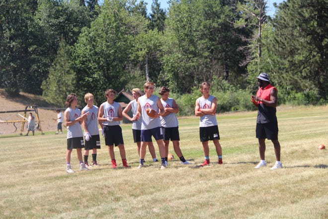 New Etna High football coach Darryl McBride, right, conducts a spring practice in early June 2021.