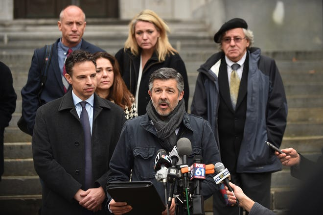 Ian Hockley, father of Dylan Hockley, one of the children killed in the 2012 Sandy Hook shooting, addresses the media after a hearing before the state Supreme Court in Hartford, Conn., Tuesday, Nov. 14, 2017. Remington, the maker of the rifle used in the Sandy Hook Elementary School shooting has offered some of the victims' families nearly $33 million to settle their lawsuit over how the company marketed the firearm to the public.