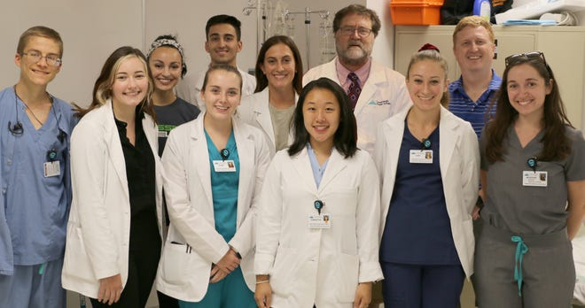 Nine students from local colleges will complete their training in Conemaugh Health System's Mentoring in Medicine program. Now in its 18th year, the program is a 10-week summer experience for undergraduate students interested in pursuing their medical education to become physicians. From left, first row are: Thomas Syphan, Kiylee Mizera, Jayme Ertter, Samantha Hong, Tori Kocsis, McKenzie Warshel. Second row: Rachel Dikum, Primo DiPaolo, Alexis Zazvrskey, Dr. William Fritz and Dr. Alex Pozun.