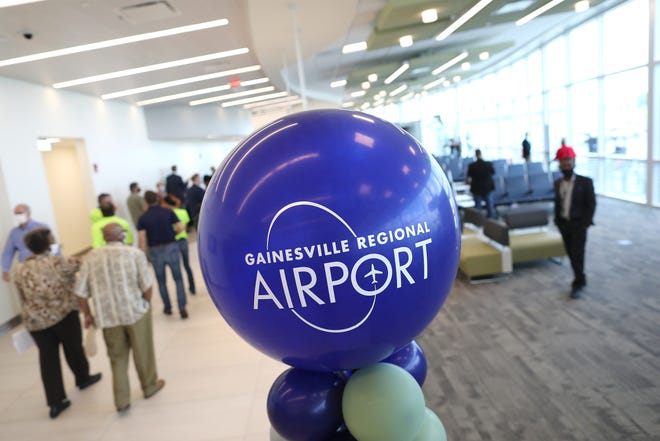 A ribbon-cutting ceremony is held July 28 for a new terminal at the Gainesville Regional Airport.