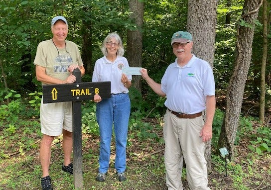Shown here are John Castrale and Teena Ligman from the Spring Mill Friends group and Tom Hohman, president of Indiana Park Alliance presenting the check for the signage.