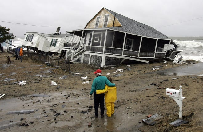 Residents view the damage done to two homes destroyed by a severe nor'easter that lashed the East Coast, Tuesday, April 17, 2007, in the Ferry Beach section of Saco, Maine.