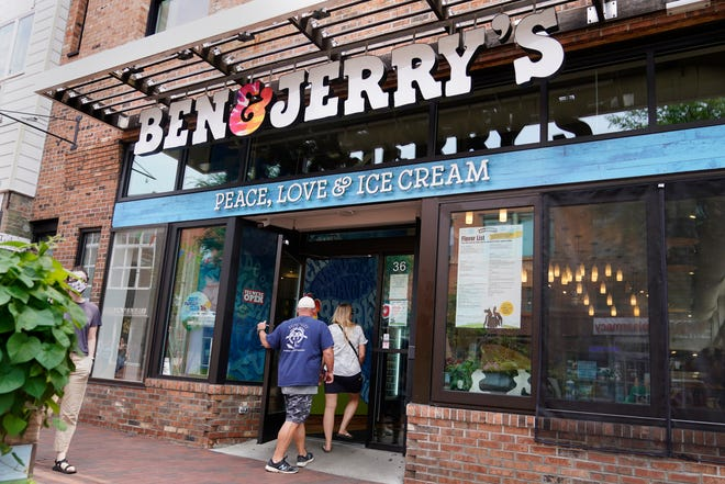 """Two patrons enter the Ben & Jerry's Ice Cream shop, Tuesday, July 20, 2021, in Burlington, Vt. Ben & Jerry's said Monday it was going to stop selling its ice cream in the Israeli-occupied West Bank and contested east Jerusalem, saying the sales in the territories sought by the Palestinians are """"inconsistent with our values""""."""