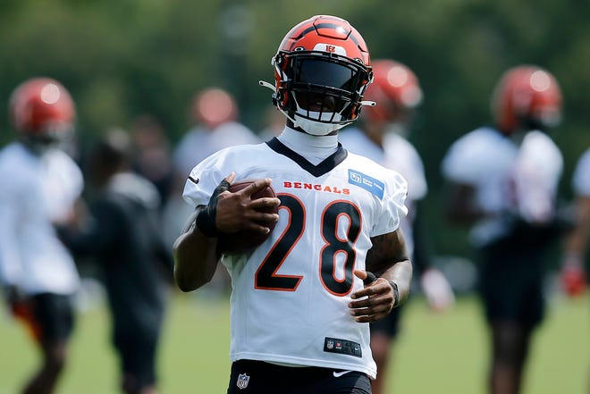 Cincinnati Bengals running back Joe Mixon (28) carries the ball down the side line during training camp practice at the Paul Brown Stadium practice facility in downtown Cincinnati on Thursday, July 29, 2021.