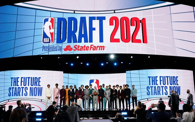 NBA commissioner Adam Silver, center, poses for a photo with players projected to be first-round draft picks before the draft.