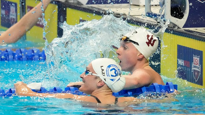 Lilly King (in IU cap) and Annie Lazor react after a women's 100m breaststroke semifinal on June 14, 2021, in  Omaha, Nebraska, during the U.S. Olympic Team Trials Swimming competition at CHI Health Center Omaha. Mandatory Credit: Rob Schumacher-USA TODAY Sports
