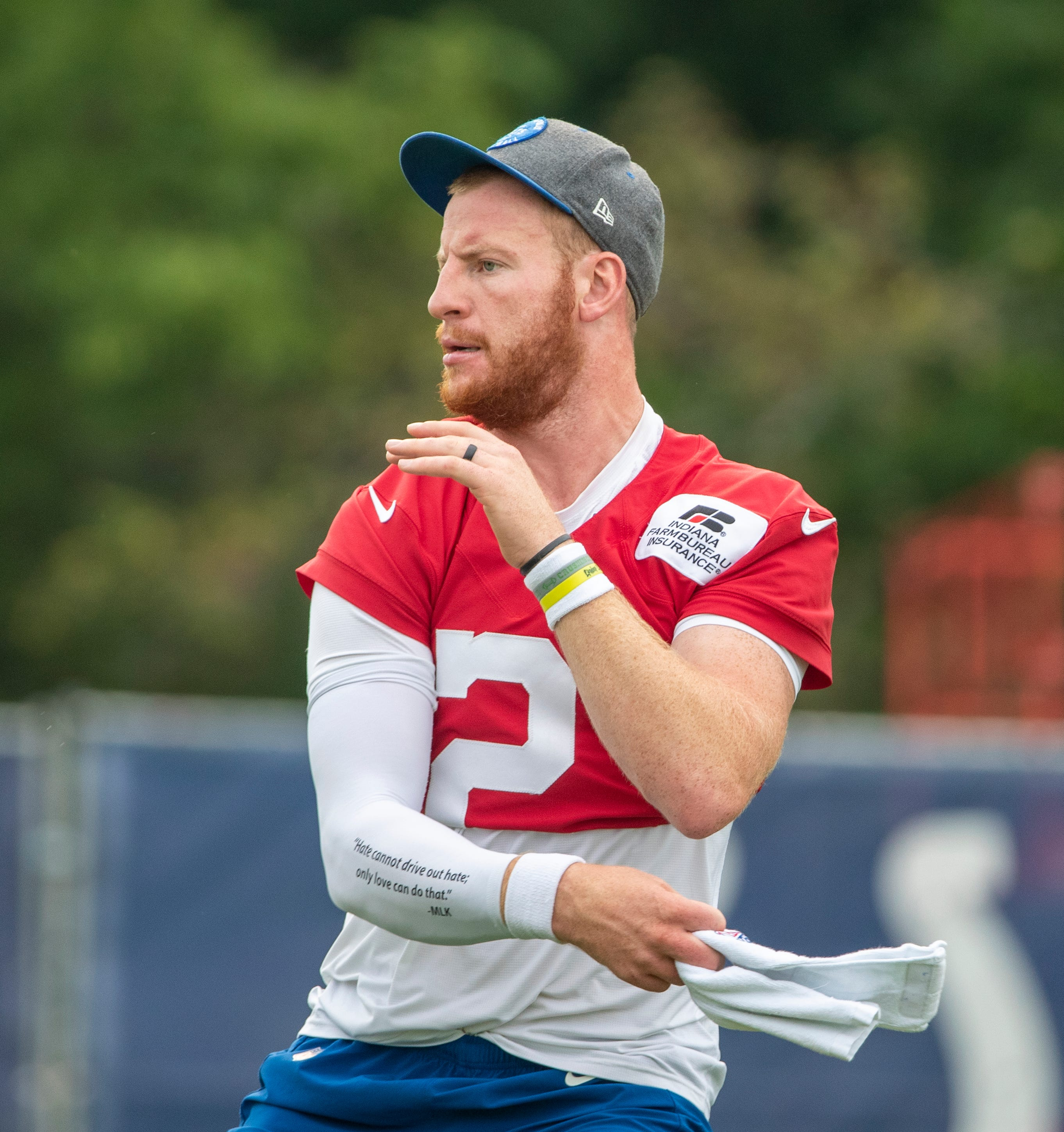 Colts QB Carson Wentz misses practice with foot injury