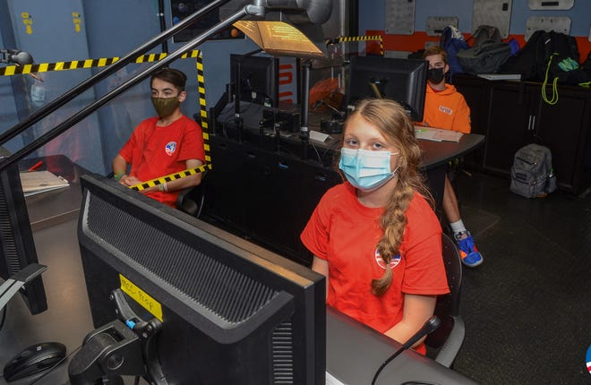 Sarah Scott, front right, sits with her teammates in the mission control center during a simulation to the International Space Station during Advanced Space Camp this summer at NASA Marshall Space Flight Center's Official Visitor Center.