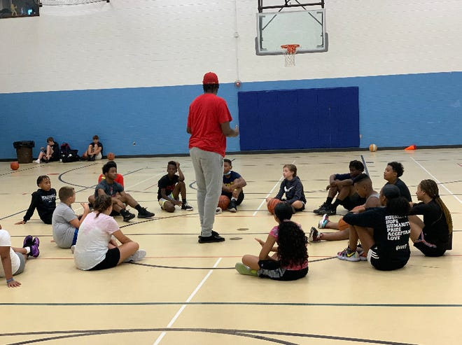 Participants of the City of Lansing's daily basketball camp receive mentoring and college prep in addition to help with their athletic skills.