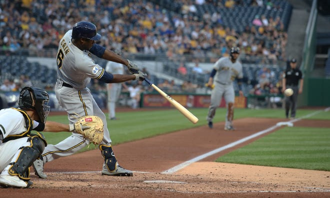 Brewers centerfielder Lorenzo Cain sends a two-run double to gap in right-center field during the fourth inning against the Pirates on Wednesday.