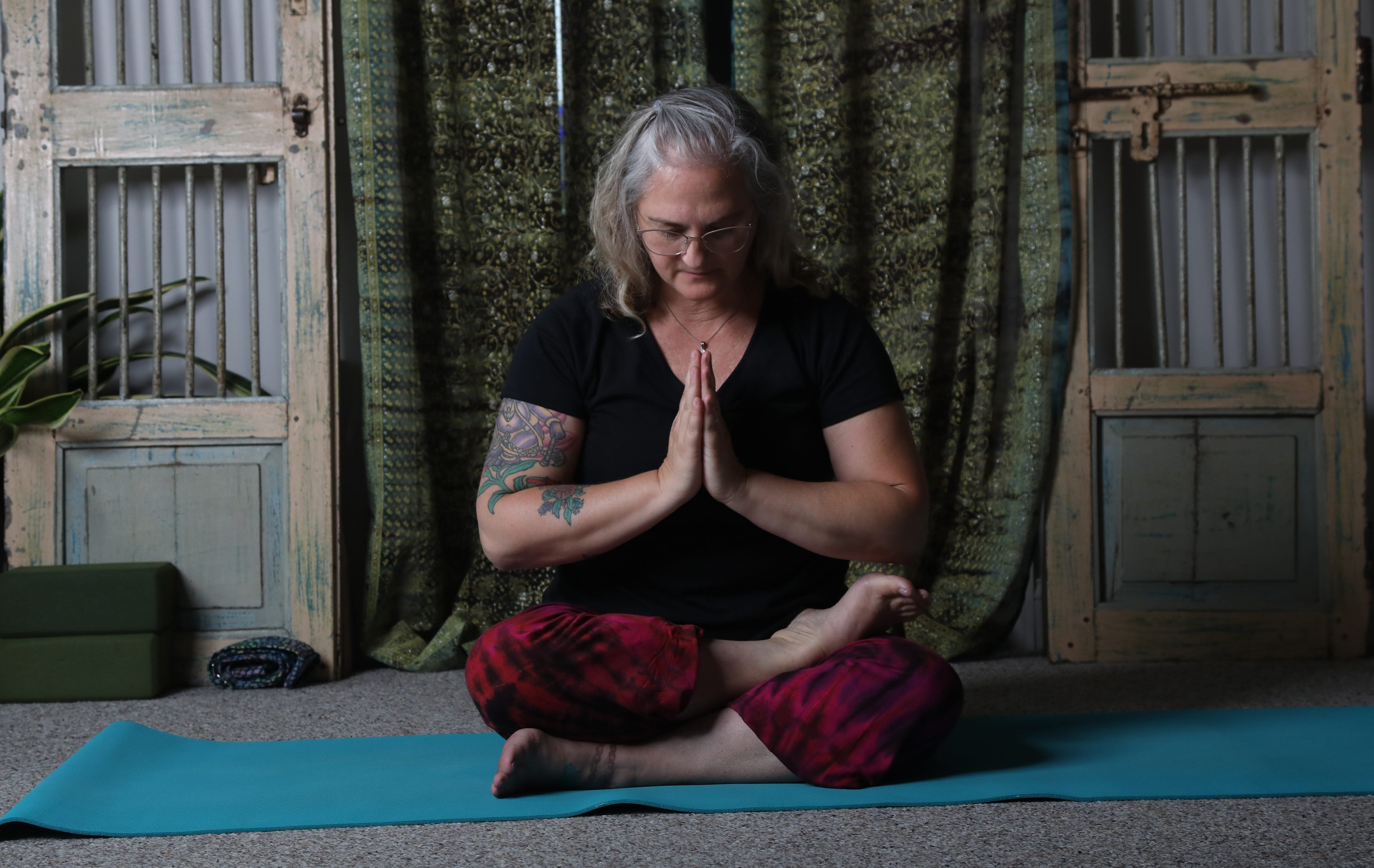Dr. Tracey Ulshafer does her Yoga workout in her Hightstown, NJ studio on July 29, 2021. As related to traditional religion, she teaches Yoga as an appreciation and acknowledgment of spiritual fulfillment.