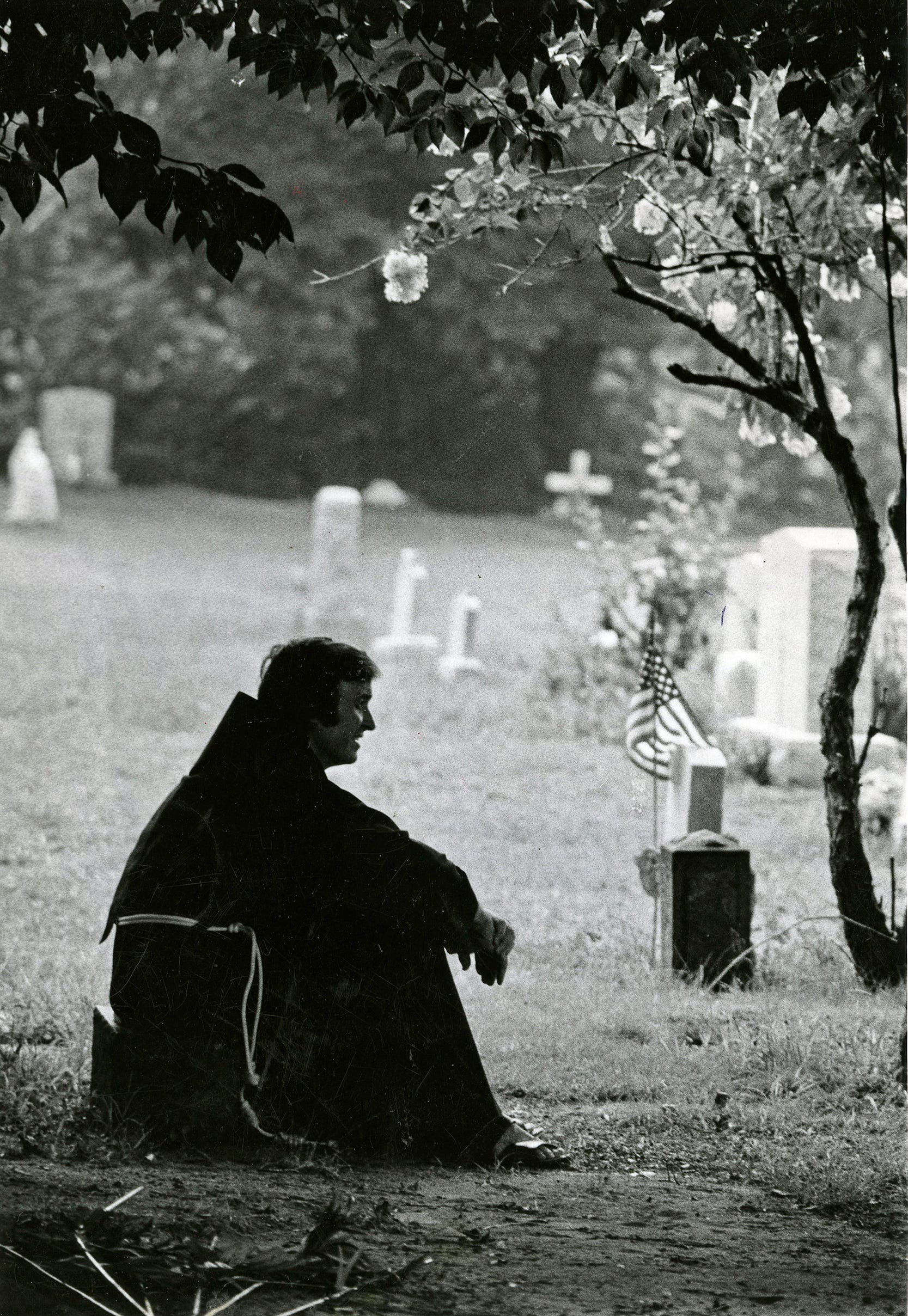 Father Mychal Judge, like St. Francis, the founder of his Franciscan order, tries to spread peace, joy, hope and love as he brings his church to the people - whether they are cemetery workers in Lyndhurst, N.J, teens relaxing on the friary lawn, or neighborhood youngsters. Wherever he goes, the brown-habited friar, seen here on August 27, 1974, is greeted affectionately as Father Mychal