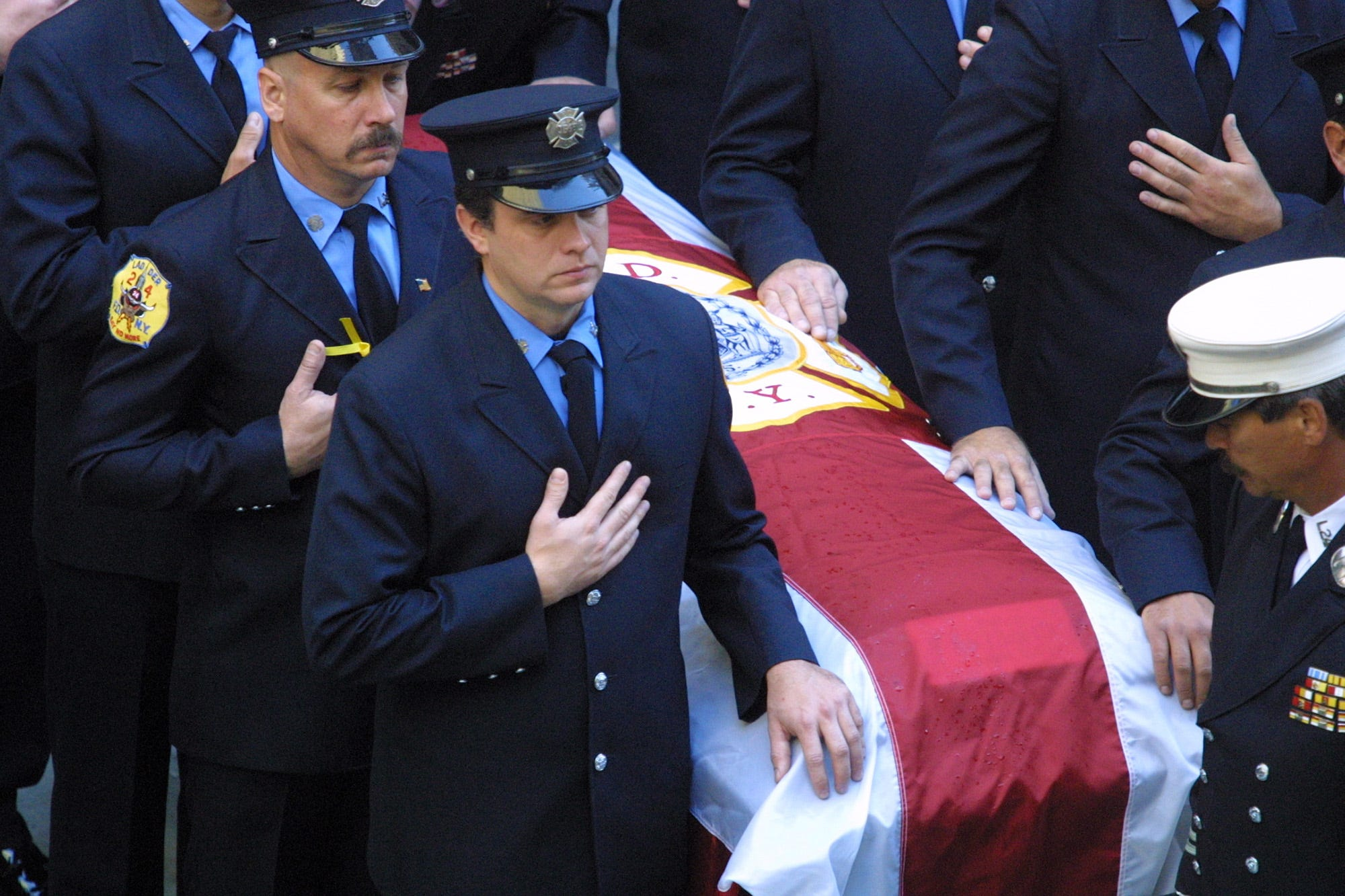 New York City Firefighter poll bearers attend to the casket of NYFD Chaplain Mychal Judge during a funeral mass at St. Francis Church on West 31st Street near 6th Ave. in New York City. Saturday, September 15, 2001.