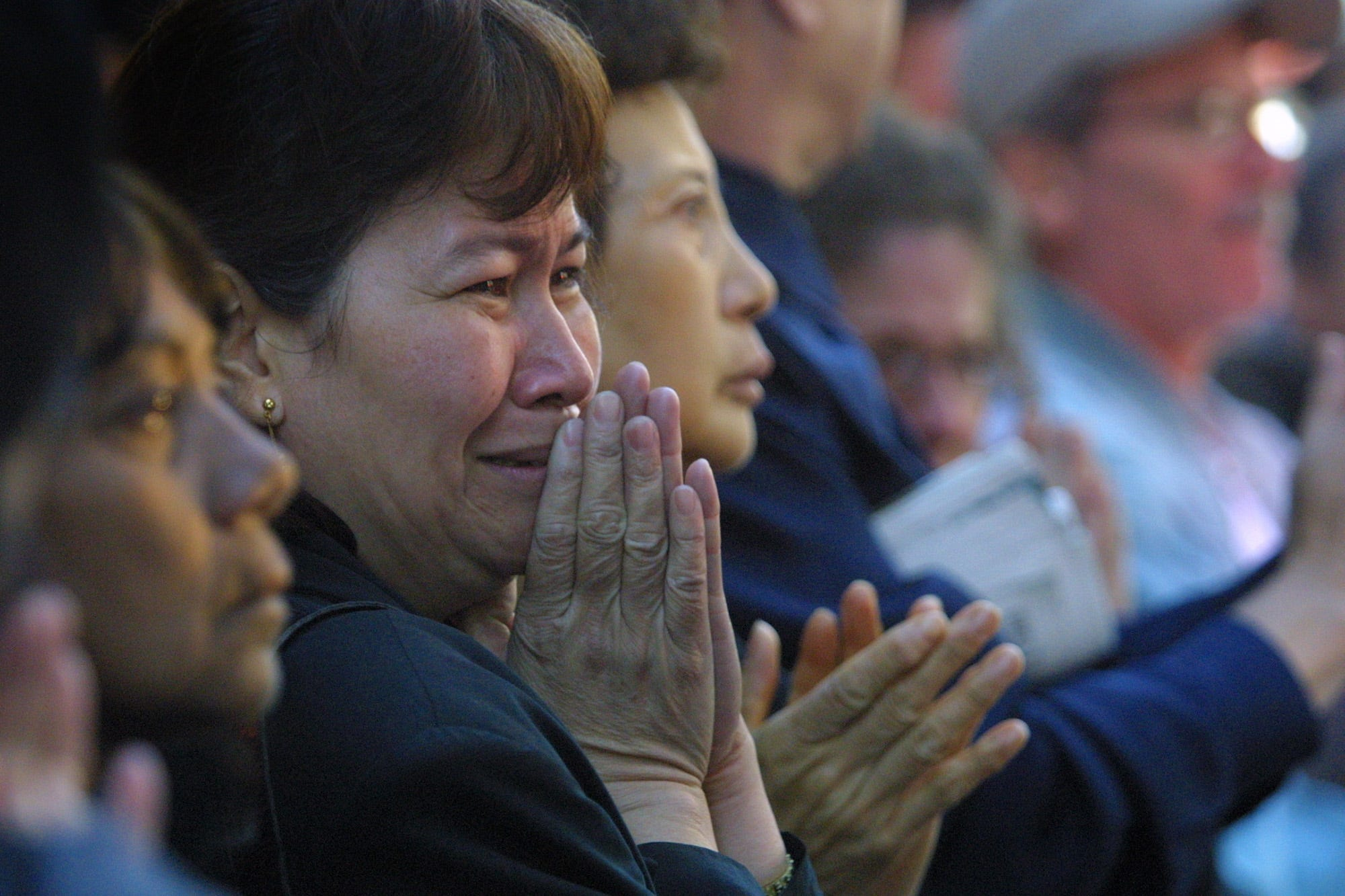 Onlookers weep at the casket of NYFD Chaplain Mychal Judge passes by following a funeral mass at St, Francis Cathedral on West 31st Street near 6th Ave. in NYC. Saturday, September 15, 2001.