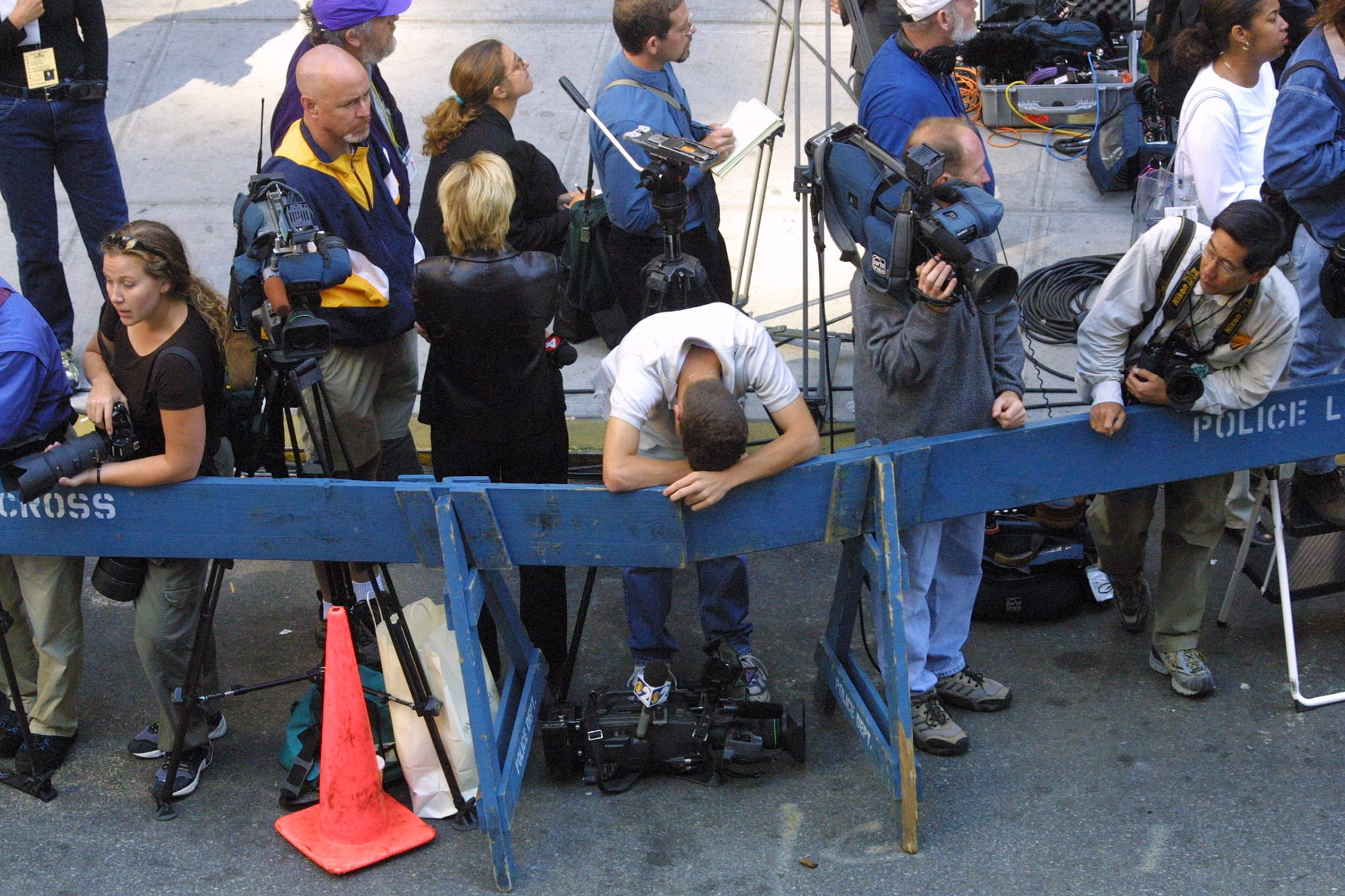 A camera man rests his head after being visibly moved during the funeral mass for NYFD Chaplain Mychal Judge at  St, Francis Cathedral on West 31st Street near 6th Ave in New York City. Saturday, September 15, 2001.