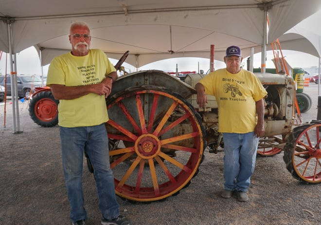 Ralf Cunningham and Jerry Frazier with an antique tractor they rescued from a field in Texas just a few months before the Eddy County Fair.