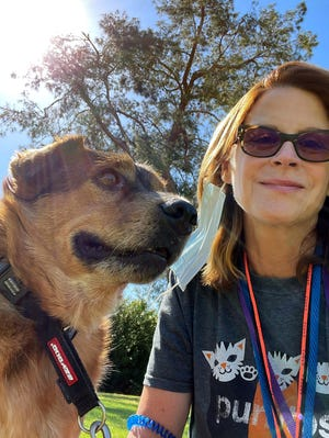 Palm Springs Animal Shelter volunteer Kristen Hirsch poses with her recently-adopted special friend, Bear.