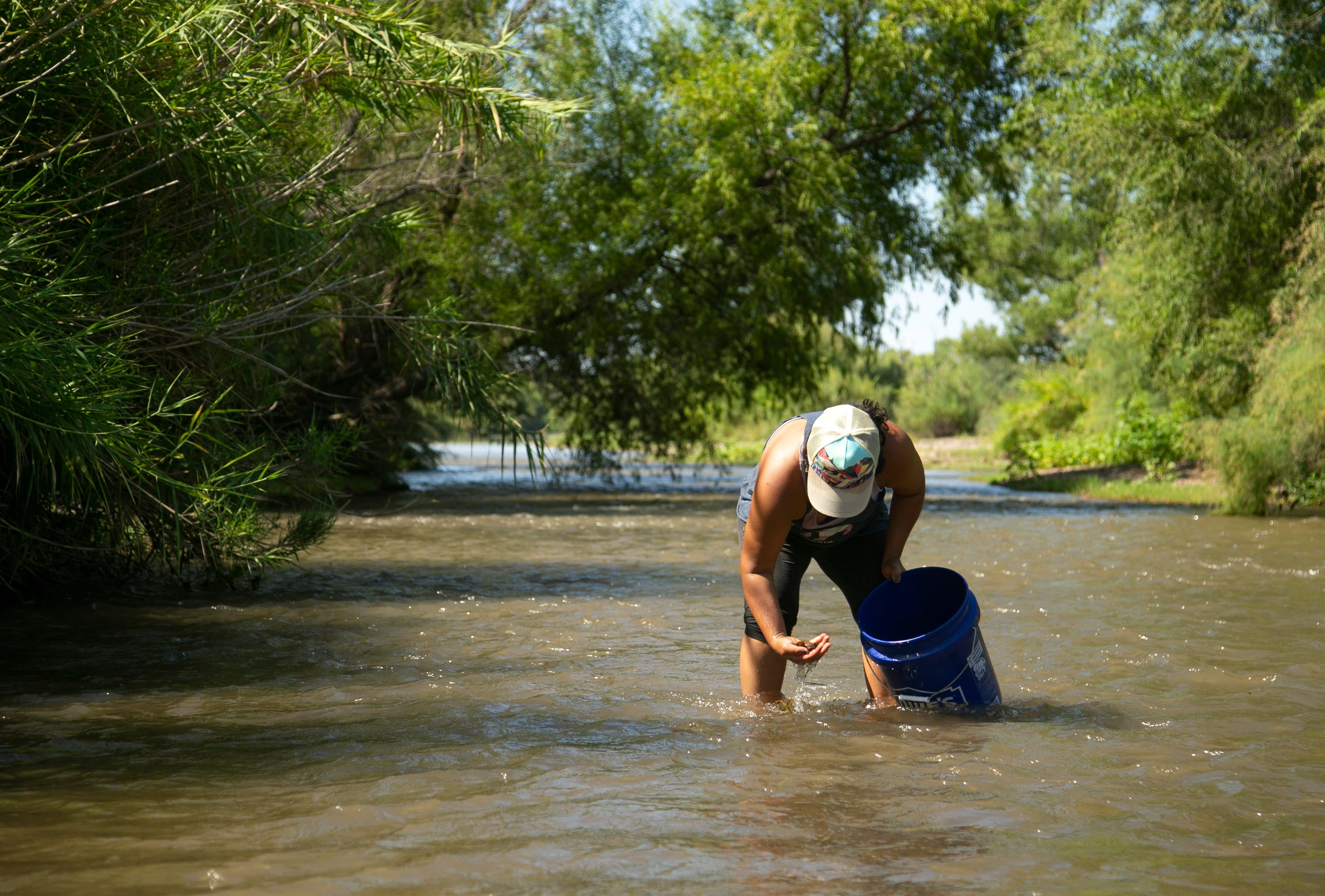 While digging for Asiatic clams in the Verde River, Jenneen Sambour is reminded of her family trips to Cambodia where she would buy clams from a roadside market, sun-dried on a metal sheet and peppered with salt, sugar and chile flakes.