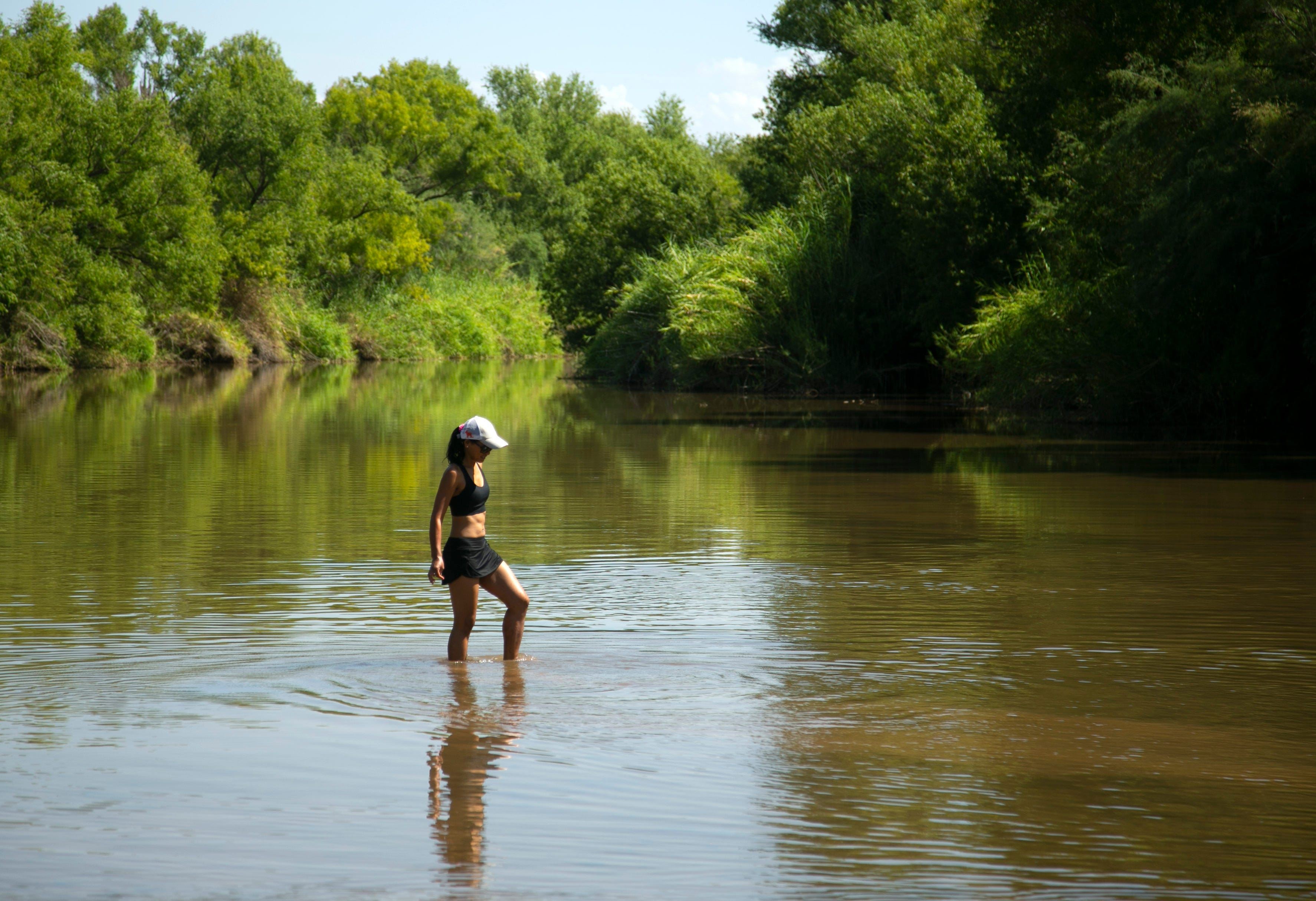 Sray Campanile of Buckeye goes clamming for Asiatic clams in the Verde River at the Needle Rock Recreation Site outside of Rio Verde on July 28, 2021.