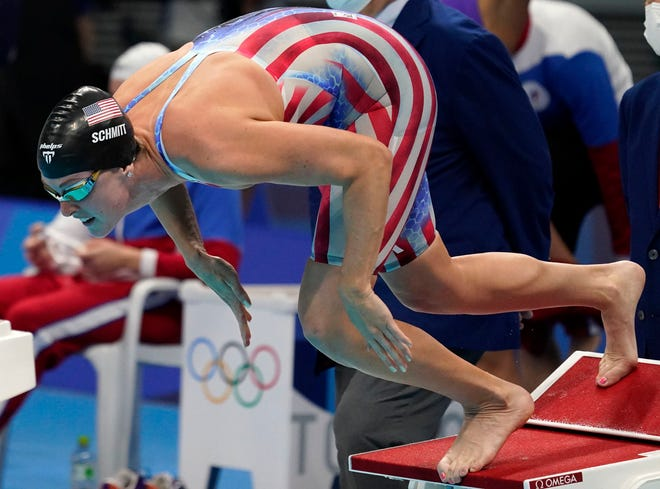 Jul 29, 2021; Tokyo, Japan; Allison Schmitt (USA) dives into the water at the start of the women's 4x200m freestyle relay during the Tokyo 2020 Olympic Summer Games at Tokyo Aquatics Centre.