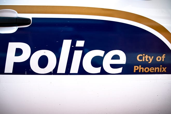 The side of a Phoenix police vehicle.