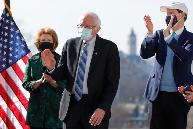 U.S. Sen. Bernie Sanders, I-Vt., is greeted during a signing ceremony the Bill Enrollment for the Biden American Rescue Plan on Capitol Hill in Washington on March 10, 2021. (Yuri Gripas/ABACA/TNS)