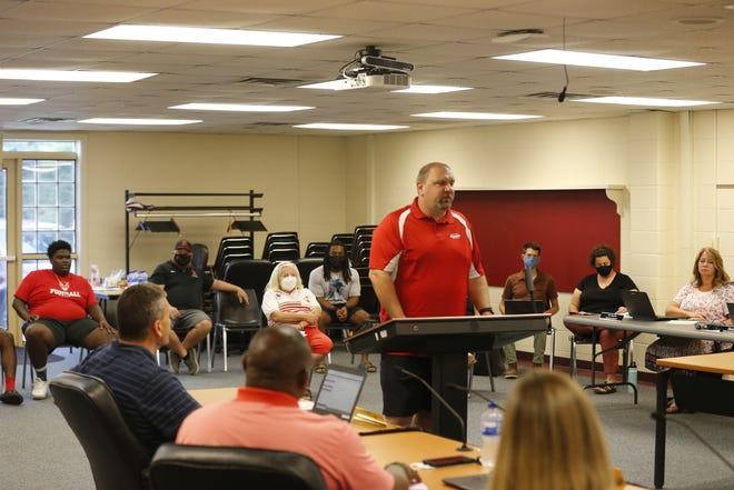 Richmond High School assistant football coach Jeremy Bane spoke in support of head coach Tony Sonsini at Richmond Community School's board meeting Wednesday, July 28, 2021.