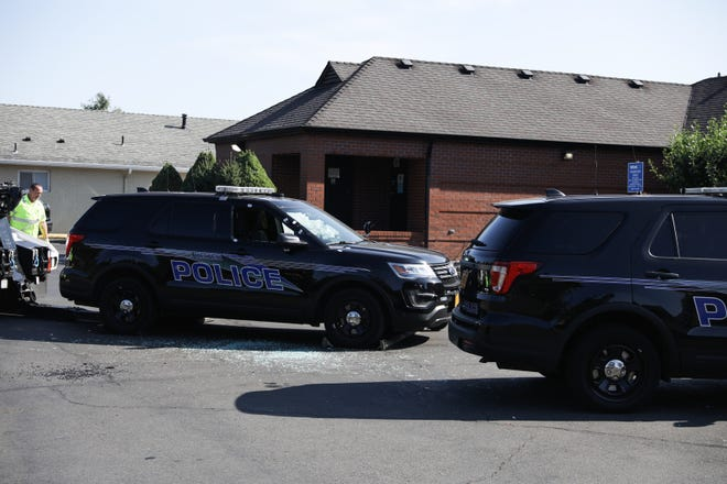 A Keizer Police vehicle with bullet damage sits in a parking lot while police investigate a shooting incident in Keizer on Thursday, July 29, 2021.